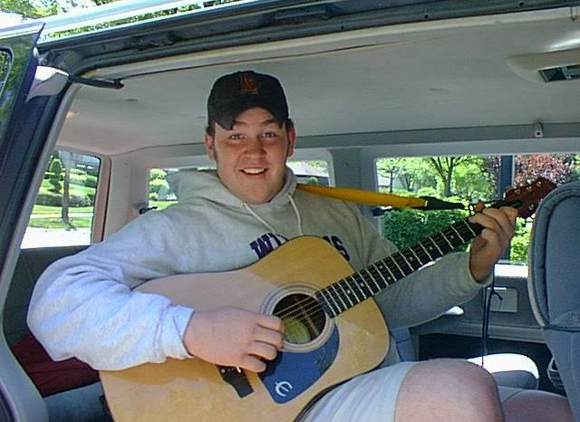Guitar player in minivan