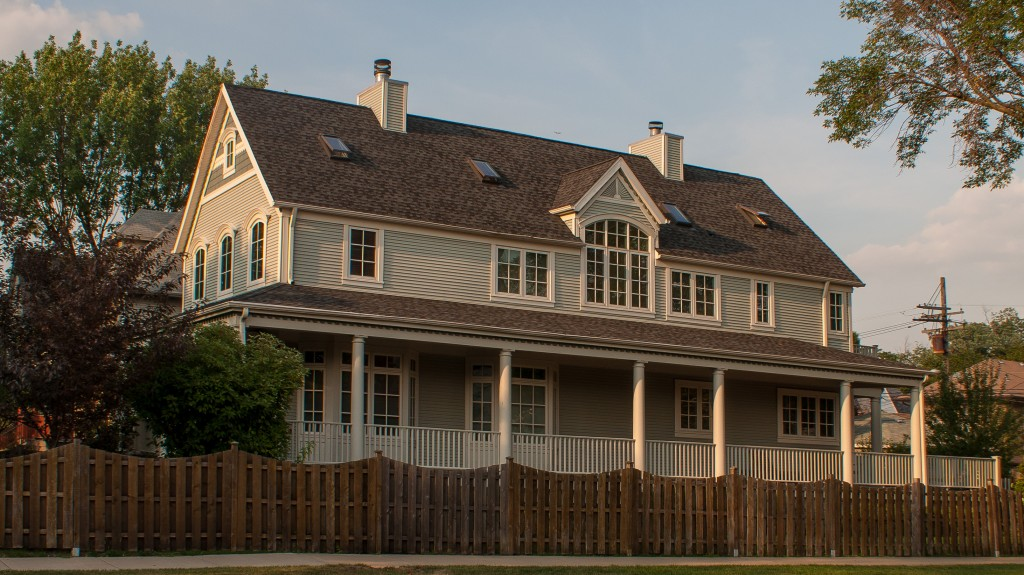 The covered wraparound porch is a classic plantation style accent